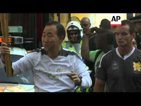 Olympic torch with Ban Ki-moon, PM Cameron, and UK Royals at Buckingham Palace