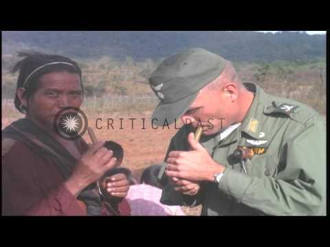 Lieutenant Colonel Hughes meets Montagnards of a village in Vietnam. HD Stock Footage