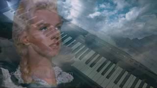 The river Of no Return ( Marilyn Monroe). Piano et arrangements: André Caron