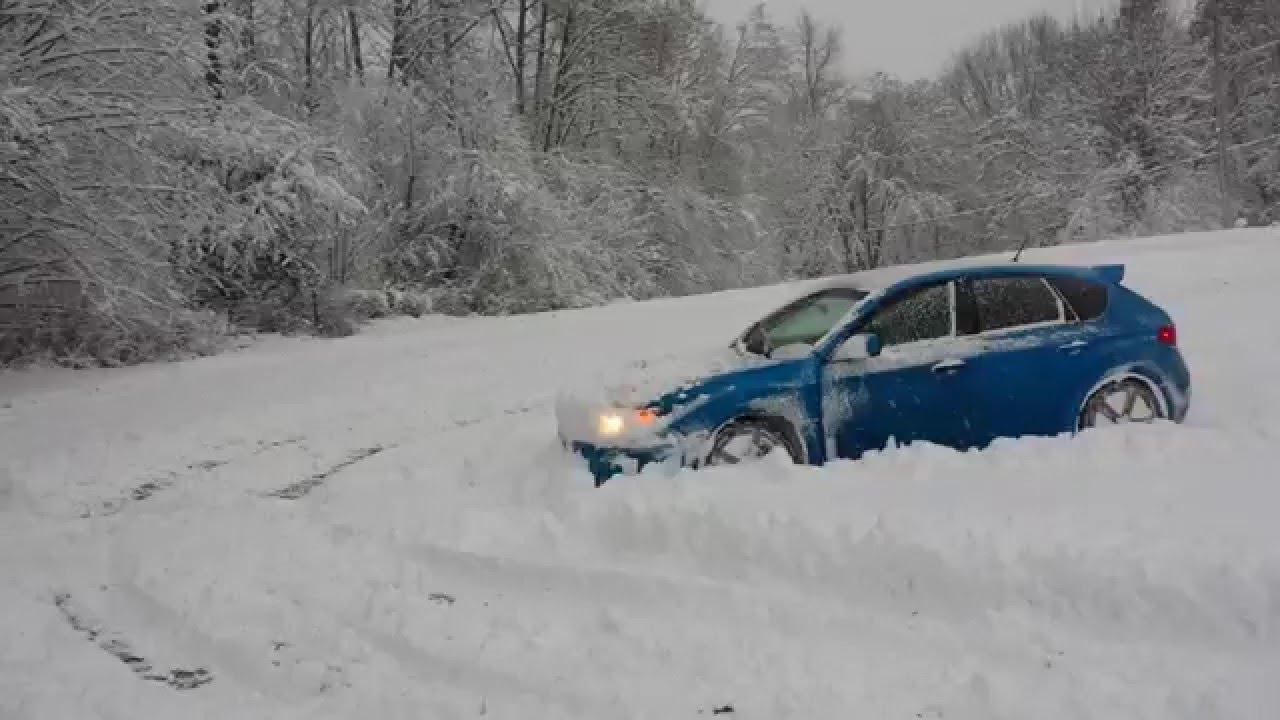 400 HP Subaru STi Plowing through 2 Feet of Snow