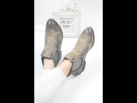 Brush off a pointed women's short boots.avi