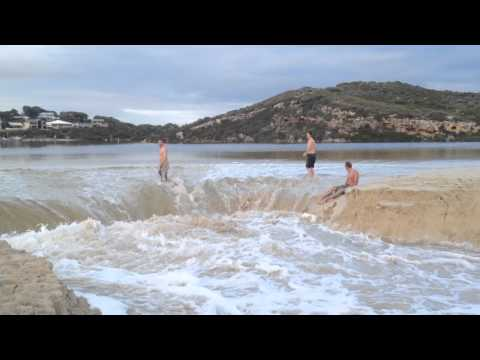Guys Body Surf When Moore River Bursts Its Banks