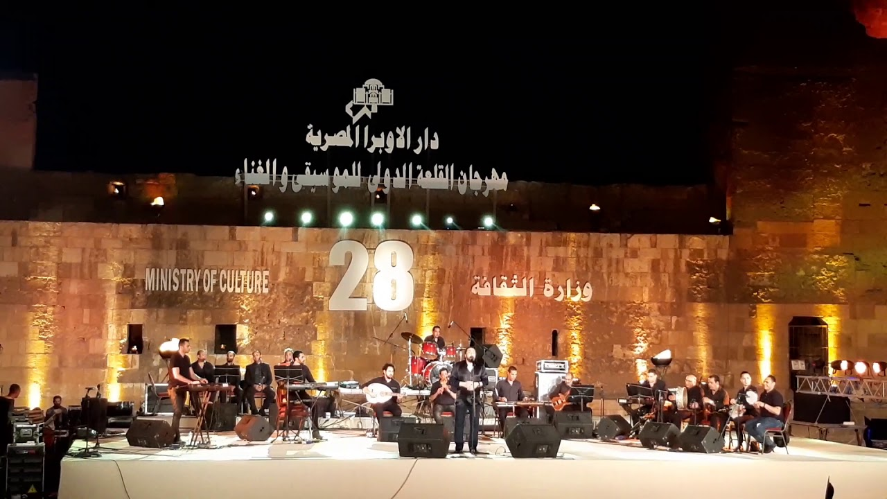 علي الحجار - تتر مسلسل بوابة الحلواني - حفل مهرجان القلعة للغناء والموسيقى ٢٠١٩