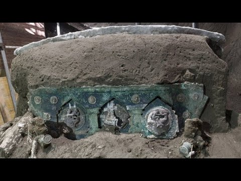 Ancient ceremonial carriage uncovered by archaeologists near Pompeii