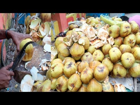 Palm fruits cutting Bangladeshi street fruits Taler Ahari or Tasty Edible jelly seed in Dhaka
