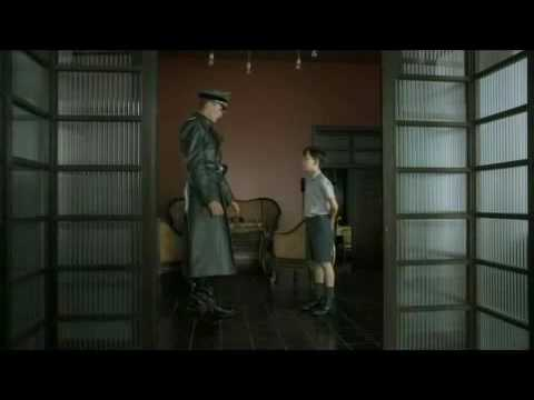 How do the film techniques in 'The Boy in the Striped Pyjamas' show the theme of friendship?
