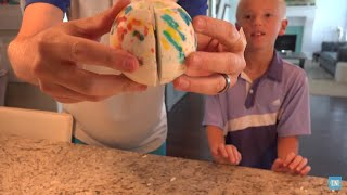 What does the inside of a giant jawbreaker look like when cut in half? We decided to find out. We could have smashed it on the ground and seen the pieces but I ...