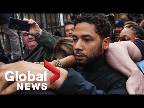 Jussie Smollett walks through media swarm after being released from custody