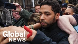 Jussie Smollett walks through media swarm after being released from custody