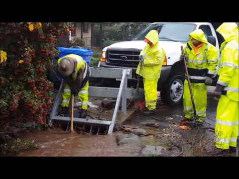 Clearing the storm drain on First St. West