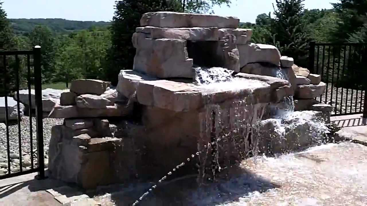 awesome pool waterfall and splash pad tanning ledge water