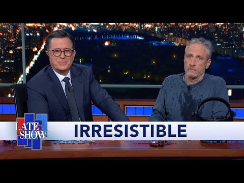 """Jon Stewart Climbs Out From Under Colbert's Desk To Debut """"Irresistible"""" Movie Trailer"""