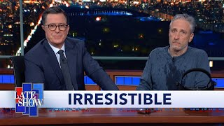 """Download Jon Stewart Climbs Out From Under Colbert's Desk To Debut """"Irresistible"""" Movie Trailer Mp3 and Videos"""