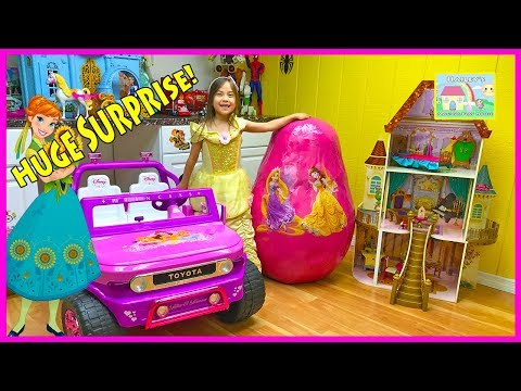 HUGE DISNEY PRINCESS SURPRISE EGG TOYS Biggest Ever Castle Disney Ride-On Belle Frozen Let it Go Mic