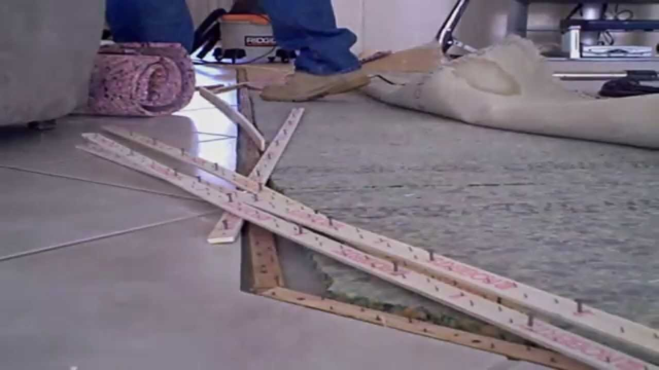 Feel tackless strip through carpeting