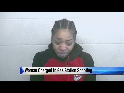 Woman charged in gas station shooting