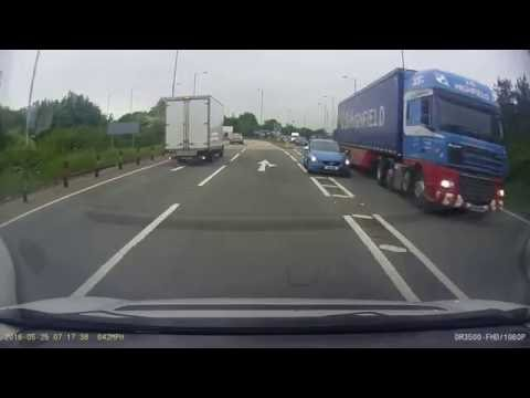 Car Overtaking Truck Exiting Island.  Newark on Trent. A46/A1.