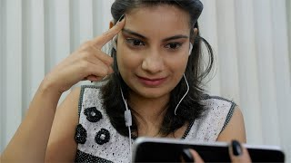 Attractive young Indian girl doing a video chat on her smartphone