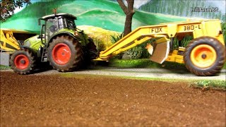 RC TRACTOR leveling land on the farm - farm toy action