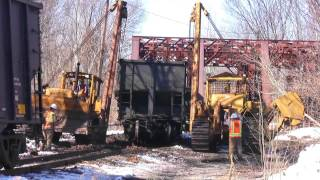 One way to rerail a 100 ton loaded coal car from derailment 40' from tracks! thumbnail