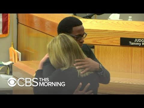 """Mother of man slain by cop says son's hug should not be """"misconstrued"""""""