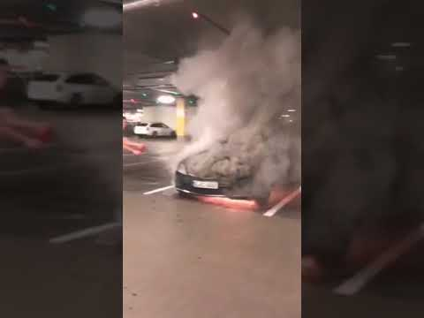 Mercedes  burning at the parking of gallery