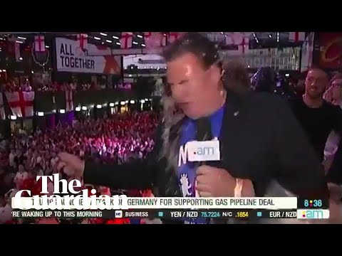 Beer Thrown In Reporter's Face, Carries On Like A Champ