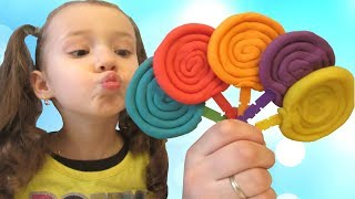 Pretends to play with Lollipops from Play Doh - Preschool toddler learn colors