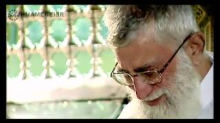 Ayatollah Khamenei cleaning the grave of Imam Raza