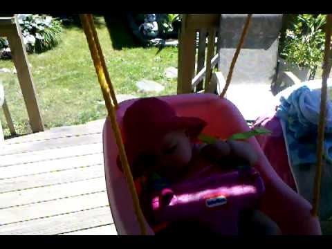Reagan on the swing under the deck