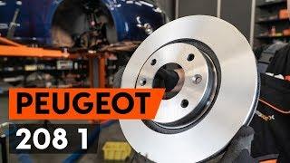 Como substituir discos de travão dianteira no PEUGEOT 208 1 (CA_,CC_) [TUTORIAL AUTODOC]