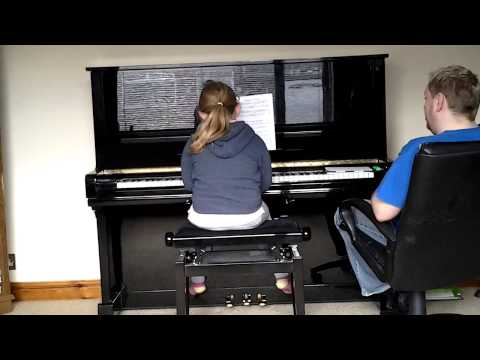 trin playing the piano