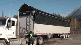 Flip-Top Tarp - SMOOTHFLOW Moving Floor Trailer by TYCROP