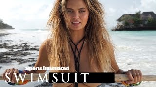 Chrissy Teigen Shows Off Her Powerlifting Moves In A Revealing Suit | Sports Illustrated Swimsuit