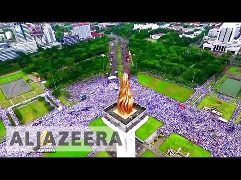 Jakarta rally: Protesters demand governor