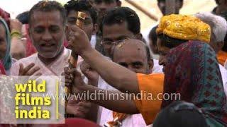 People daubed in colours celebrate Holi - Vrindavan