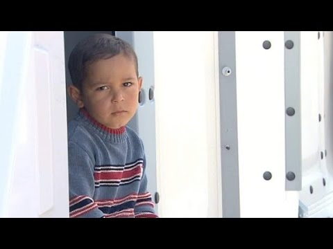 Refugees wait confined in enclosed camps in Lesbos