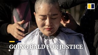 Wives of detained Chinese human rights lawyers shave heads in protest