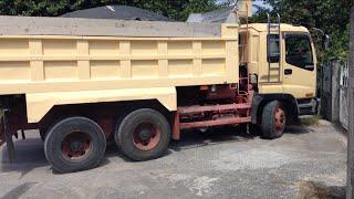 Isuzu dump truck dumping sand