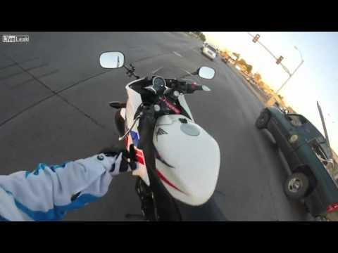 Good Hearted Motorcycle Rider Saves Kitten in Traffic