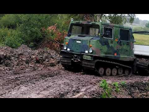 Hägglunds Bv206 with trailer