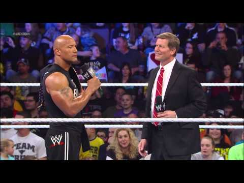 The Rock takes down People Power, delivering a People's Elbow to a returning John Laurinaitis: Smack
