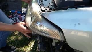 Renault Laguna 2 jak wyjąć przedni reflektor.