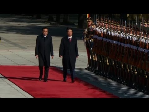Japan's Abe gets cordial welcome in rare China visit
