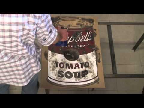 burning campbells tomato soup warhol
