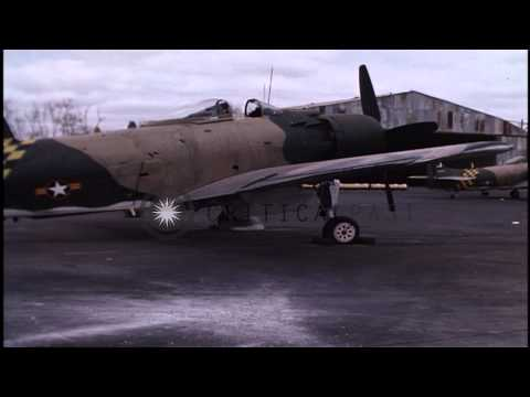 Damaged Vietnamese A1-E and USAF F-100 jet at Bein Hoa Air Force Base, Vietnam. HD Stock Footage