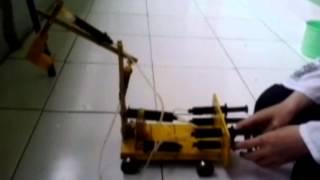 video pembuatan miniatur excavator