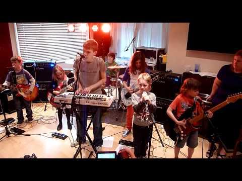 Mini band at rock school  play Knights Of Cydonia by Muse