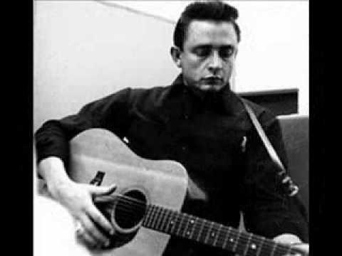 Johnny Cash - When th Man Comes Around ( w/ lyrics)