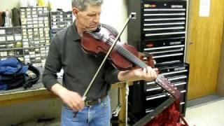 Dan Robinson from Mankato Music Mart playing TeeJays 10-String Fiddle